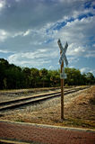 Beautiful view of railroad tracks in florida vanis. Beautiful view of railroad tracks vanishing into the distance  in florida with cloud filled sky and railroad Stock Photos