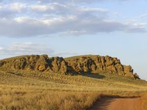 Beautiful view of the red mountain. Natural elevation in the steppe stock photography