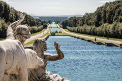 Beautiful view of Reggia di Caserta Italy, with marble statue Royalty Free Stock Photo