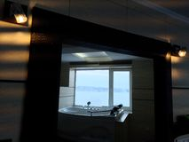 Hot tub in the hotel room. Beautiful view, relaxation and relaxation. Photo through the reflection of the mirror stock photos