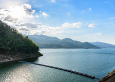 Beautiful view of the reservoir over Srinakarin dam. Located in Kanchanaburi province in the western of Thailand with beautiful blue sky, white cloud, golden Royalty Free Stock Photos