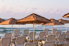 Beautiful view of a resort beach with sunshades Royalty Free Stock Photo