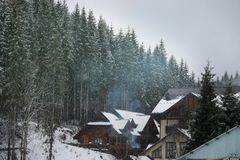 Beautiful view of resort with cozy cottages on snowy day. Winter vacation stock image