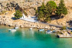 Amazing view on coast in Lindos in Rhodes island, Greece. Beautiful view on Rhodes island with typical greek chapel stock photography
