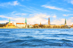 Beautiful view of the Riga Castle, St. Peter`s Church and the tower of the Dome Cathedral on the banks of the Daugava River Stock Photography