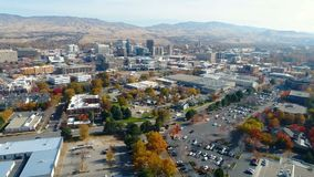 Beautiful view of a river in fall and the Boise Idaho skyline. Autumn colors line the Boise river with the city skyline stock footage
