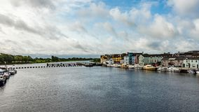 Beautiful view of the river Shannon with boats anchored on the coast and picturesque houses. In the Athlone town, wonderful cloudy day in the county of stock photos