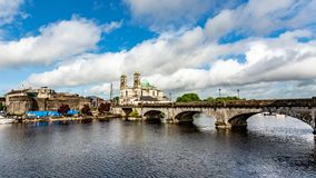 Beautiful view of the river Shannon, the bridge, the parish church of Ss. Peter and Paul and the castle in the village of Athlone. Wonderful day in the county royalty free stock images