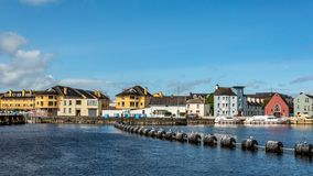 Beautiful view of the river Shannon and picturesque houses in the town of Athlone. Wonderful and relaxed day in the county of Westmeath, Ireland royalty free stock images