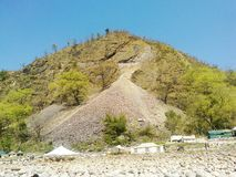 River side Rocks, Tent and Mountain royalty free stock image