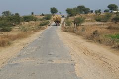 A beautiful view of the road in the country of Punjab. A view of country village roads and fields in Punjab, Pakistan, Asia, India, where a brick kiln emitting royalty free stock photography