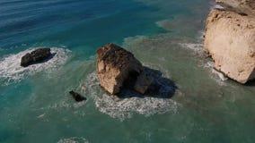 Beautiful view of rocks in a blue ocean stock video
