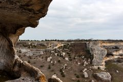 View from Eski-Kermen city in Crimea. Beautiful view with rocks and trees from above the City of Eski-Kermen in Crimea Stock Photos