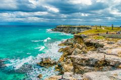 Beautiful view of rocky cliff at sunrise on the the southern part of the Isla Mujeres in Caribbean, Mexico royalty free stock photos