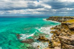 Beautiful view of rocky cliff and turquoise water at sunrise on the the southern part of the Isla Mujeres in Caribbean. Mexico Stock Photos