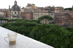 Beautiful view of Rome and cup with cafe latte Royalty Free Stock Images