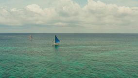 Beautiful view of the sailboat in the tropical sea, Boracay, Philippines. Sailing boat with tourists stock video