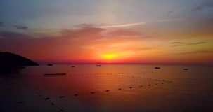 Beautiful view of sailing at sunrise, calm sea nature scene on summer morning. Drone flight stock video