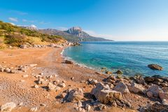 Beautiful view of the sandy beach and the rocky coast of the Black Sea, the landscape of the Crimea stock images