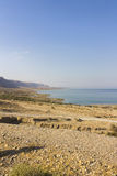 Beautiful view on the sandy Dead sea beach Stock Photos