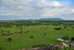 Serengeti, Tanzania, Africa. Beautiful view of the savanna from the top of the granite dike in the Serengeti National Park during the sunset, Tanzania, Africa Stock Photos