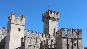 Beautiful view of Scaligero Castle in sunny day. Sirmione, Italy - Circa June 2019. Beautiful view of Scaligero Castle in sunny day stock video