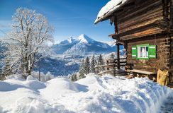 Winter wonderland scenery in the Alps with traditional mountain stock image