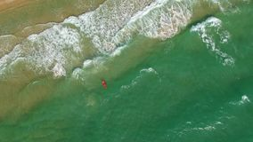 Beautiful View Of The Sea From Above Whirls Above The Surfers. Surfers train and rest in bright sea weather and catch a wave stock video