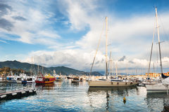 Beautiful view of the sea coast with yachts at sunset Stock Photo