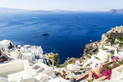 Beautiful view of the sea and islands at sunset. Oia town, Santorini island, Greece. Stock Photos