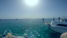 Beautiful view of the sea. near the beach.  snorkeling in the beautiful sea. near the corals and fish. cyan warm water. active lif stock video footage