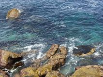 BEAUTIFUL VIEW OF THE SEA AND THE ROCKS ON A SUNNY DAY royalty free stock images
