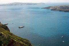 Beautiful view of the sea, the ship, the volcano on a warm sunny day. Photos from the observation deck of the Greek city of Fira royalty free stock image