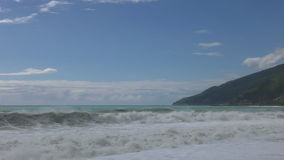 Beautiful view on seashore with waves. At sunny day stock footage