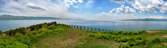 Beautiful view of Sevan lake with turquoise water and green hills, Sevan, Armenia.  stock photo