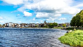 Beautiful view of the Shannon River the village of Athlone in the background. Wonderful sunny day with a blue sky and white clouds in the county of Westmeath royalty free stock photos