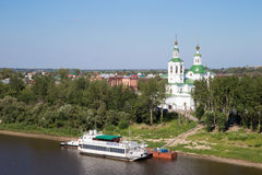 Beautiful view of the ship and the church in the background. Tyumen, Russia - August 13 2016. Beautiful view to the ship and the church in the background Royalty Free Stock Photography