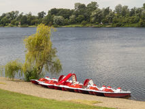 Beautiful view of Silver Lake in the morning with red pedalos on Royalty Free Stock Image