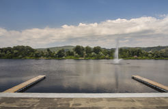 Beautiful view of Silver Lake with two wooden piers and fountain Royalty Free Stock Photo