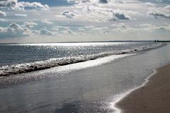 Beautiful view of silver sparkly ocean. Royalty Free Stock Images