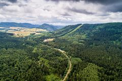 Dzikowiec ski lift and Kamienne Mountains aerial view royalty free stock image
