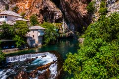 The spring of the river Buna. Beautiful view on the small waterfall of the Buna river in Blagaj royalty free stock photography