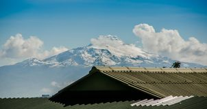 Beautiful view of the snow caped Illinizas volcano, in the Ecuadorian Andes, on a sunny and overcast morning.  Royalty Free Stock Photo