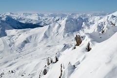 Beautiful view of snow covered rocks and mountains in the alpine ski resort La Plagne royalty free stock photos