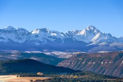 Beautiful view of snow covered Sneffels Range in a bright daylig. Beautiful morning view of snow covered Sneffels Range with blue sky near Ridgway, Colorado, USA Stock Photo