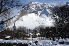 Beautiful view of a snow covered village at winter. In Rametea (Torocko), Transylvania, Romania Stock Photography