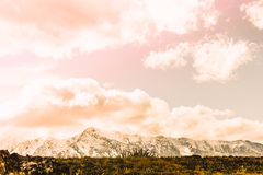 Beautiful view of the snowy mountain peaks. Colorful mountain valley with rocks royalty free stock photos