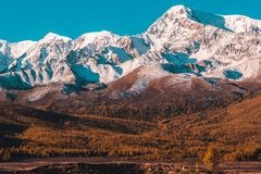 Beautiful view of the snowy mountain peaks. Colorful mountain valley with rocks stock image