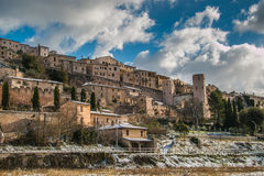 Beautiful view of Spello medieval village covered by snow Stock Photography
