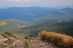 Beautiful view from the stone peaks of the mountain ranges of Hoverla Ukrainian Carpathian mountains covered with stock images